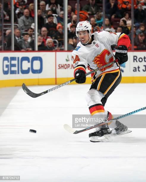 Travis Hamonic of the Calgary Flames shoots the puck against the Philadelphia Flyers on November 18 2017 at the Wells Fargo Center in Philadelphia...