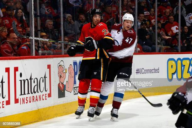 Travis Hamonic of the Calgary Flames skates against Dominic Toninato of the Colorado Avalanche during an NHL game on February 24 2018 at the...