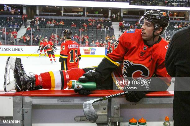 Travis Hamonic of the Calgary Flames stretches at warm up in a NHL game against the Vancouver Canucks at the Scotiabank Saddledome on December 09...