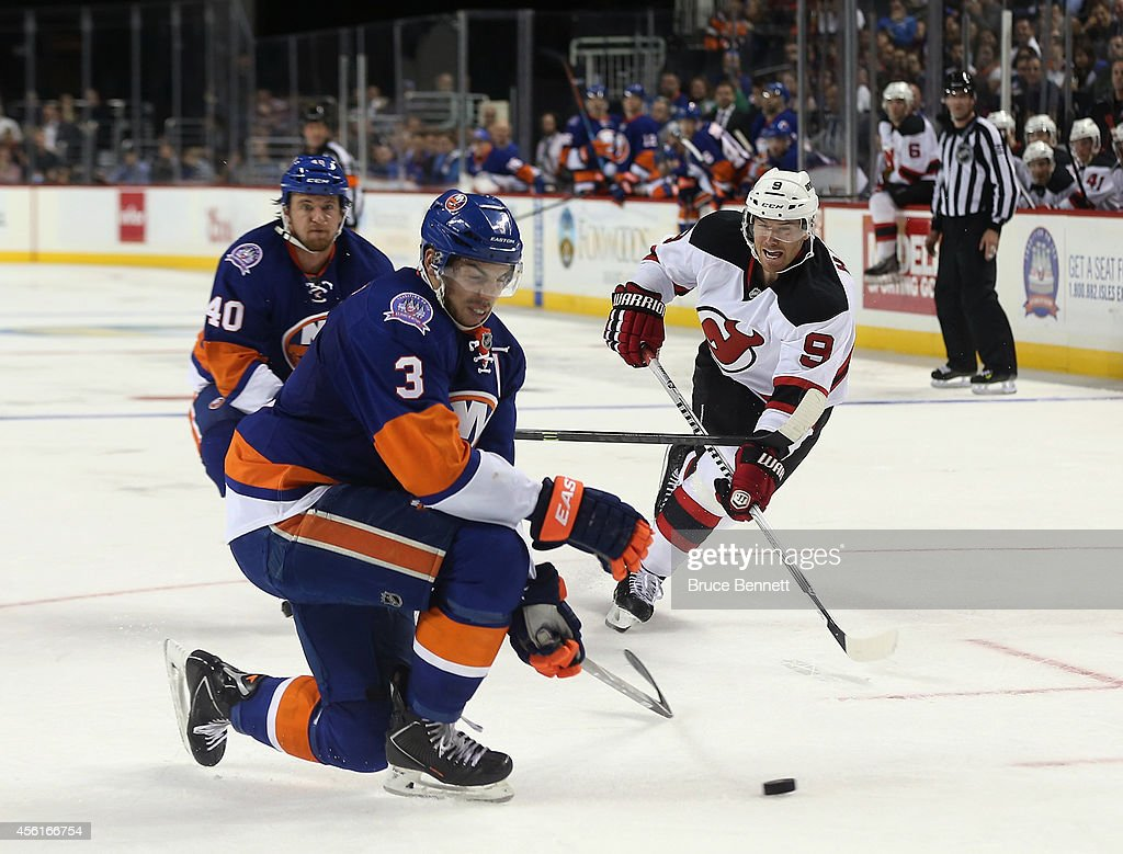 Travis Hamonic #3 of the New York Islanders blcoks a shot by Martin Havlat #9 of the New Jersey Devils at the Barclays Center on September 26, 2014 in the Brooklyn borough of New York City. The Islanders defeated the Devils 3-2 in the shootout.