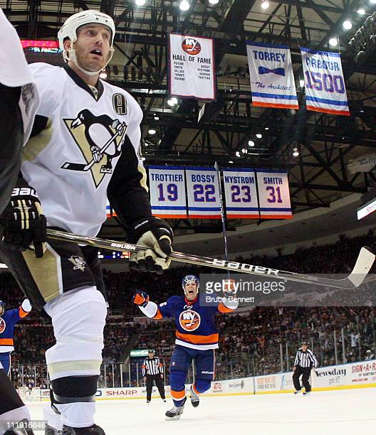 Travis Hamonic of the New York Islanders scores at 1925 of the third period to tie the score at 33 against Brooks Orpik of the Pittsburgh Penguins at...