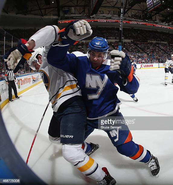 Travis Hamonic of the New York Islanders skates against the Buffalo Sabres at the Nassau Veterans Memorial Coliseum on April 4 2015 in Uniondale New...