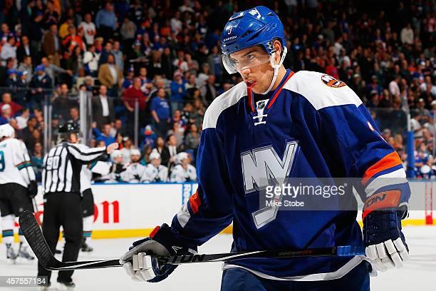 Travis Hamonic of the New York Islanders skates against the San Jose Sharks at Nassau Veterans Memorial Coliseum on October 16, 2014 in Uniondale,...