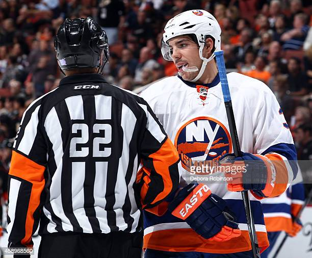 Travis Hamonic of the New York Islanders talks with referee Ghislain Hebert during the game against the Anaheim Ducks on November 5 2014 at Honda...