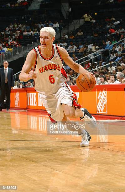 Travis Hansen of the Atlanta Hawks drives against the Philadelphia 76ers during the game at Philips Arena on April 6 2004 in Atlanta Georgia The...
