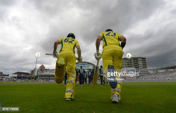 Travis Head and D'Arcy Short walk out to bat during the third Royal London OneDay International match between England and Australia at Trent Bridge...