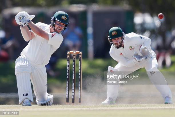Travis Head bats in front of keeper Matthw Wade during day two of the Australian Test cricket intersquad match at Marrara Cricket Ground on August 15...