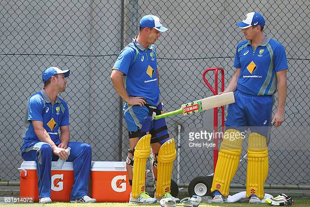 Travis Head Chris Lynn and James Faulkner talk during an Australian nets session at The Gabba on January 12 2017 in Brisbane Australia