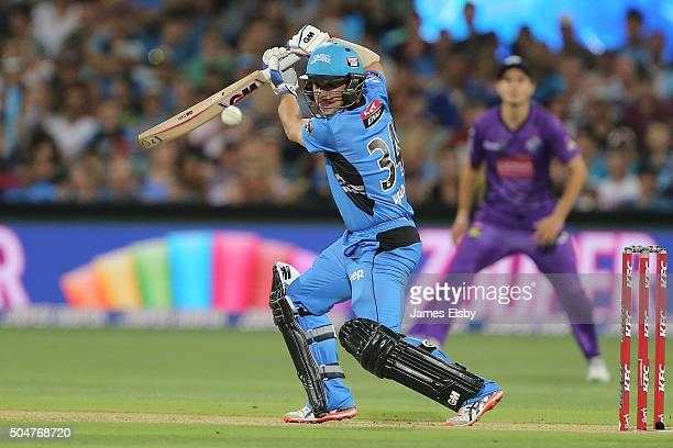 Travis Head of Adelaide plays a shot during the Big Bash League match between the Adelaide Strikers and the Hobart Hurricanes at Adelaide Oval on...