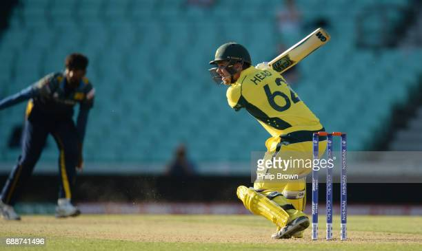 Travis Head of Australia bats during the ICC Champions Trophy Warmup match between Australia and Sri Lanka at the Kia Oval cricket ground on May 26...