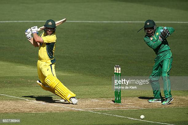 Travis Head of Australia bats in front of Mohammad Rizwan of Pakistan during game five of the One Day International series between Australia and...