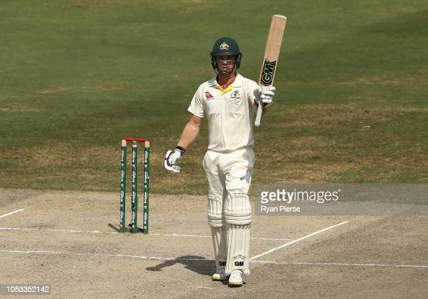 Travis Head of Australia celebrates after reaching his half century during day five of the First Test match in the series between Australia and...