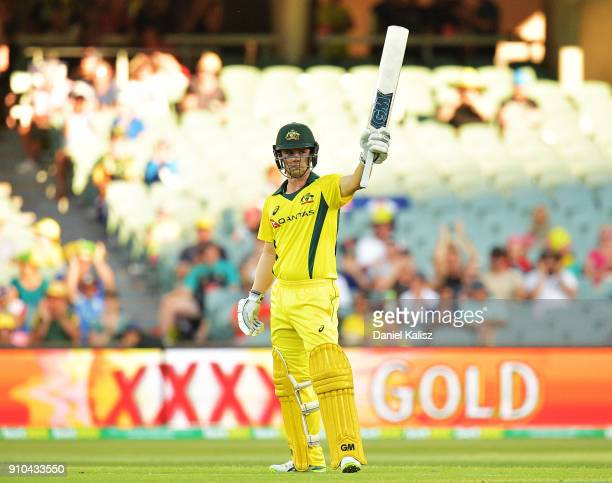 Travis Head of Australia celebrates after reaching his half century during game four of the One Day International series between Australia and...