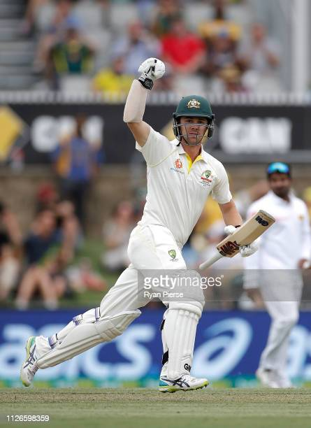 Travis Head of Australia celebrates after reaching his maiden test century during day one of the Second Test match between Australia and Sri Lanka at...