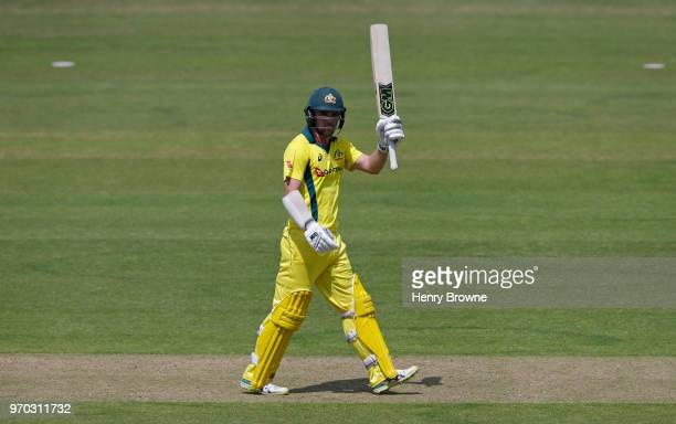 Travis Head of Australia celebrates his half century during the One Day Tour match between Middlesex and Australia at Lord's Cricket Ground on June 9...