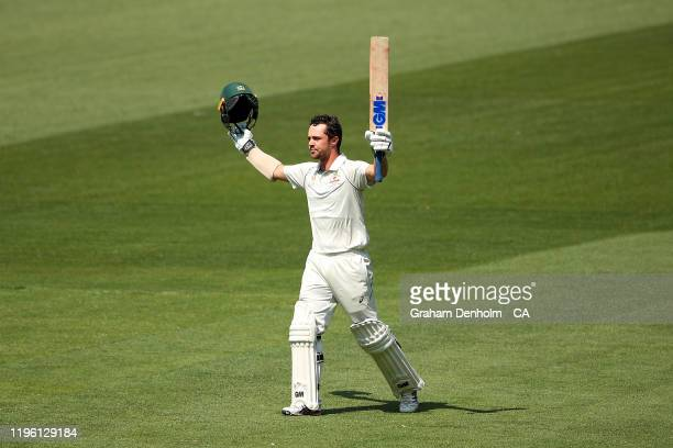 Travis Head of Australia celebrates scoring 100 runs during day two of the Second Test match in the series between Australia and New Zealand at...