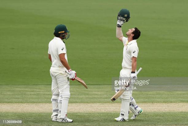 Travis Head of Australia celebrates scoring his maiden Test century during day one of the Second Test match between Australia and Sri Lanka at Manuka...