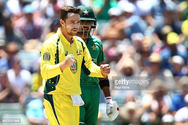 Travis Head of Australia celebrates the wicket of Asad Shafiq of Pakistan during game three of the One Day International series between Australia and...