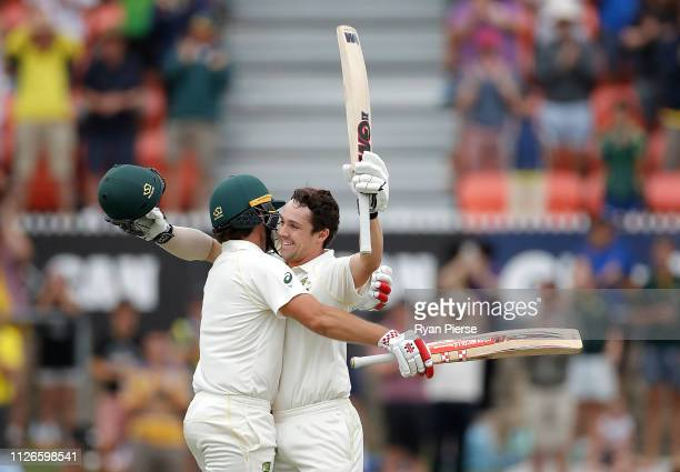 Travis Head of Australia celebrates with Joe Burns of Australia after reaching his maiden test century during day one of the Second Test match...