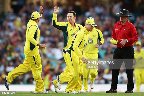 Travis Head of Australia celebrates with team mates after taking the wicket of Babar Azam of Pakistan during game four of the One Day International...