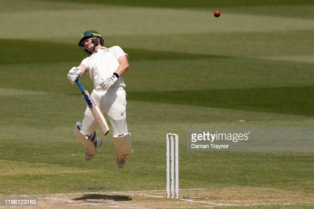 Travis Head of Australia evades a short ball during day two of the Second Test match in the series between Australia and New Zealand at Melbourne...