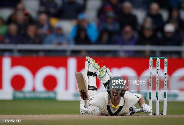 Travis Head of Australia falls to the ground after being struck in the pad by a deliver from Ben Stokes of England during day one of the 4th...