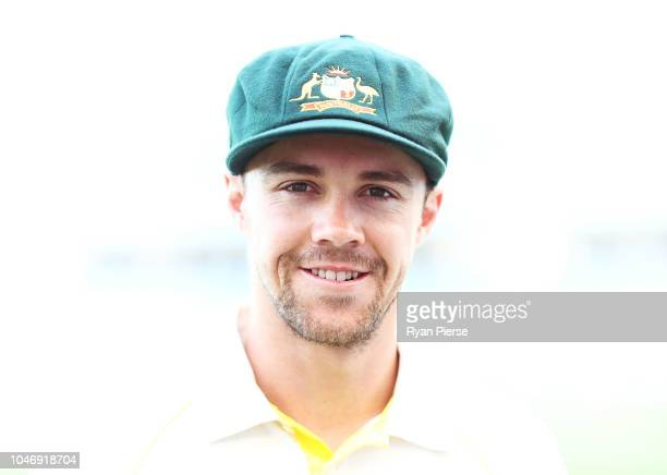 Travis Head of Australia poses after receiving their Baggy Green Caps during day one of the First Test match in the series between Australia and...
