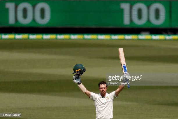 Travis Head of Australia raises his bat after scoring 100 runs during day two of the Second Test match in the series between Australia and New...