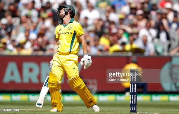 Travis Head of Australia reacts after being bowled out during game one of the One Day International Series between Australia and England at Melbourne...