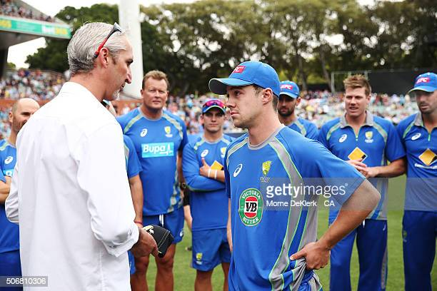 Travis Head of Australia receives his Australian cap from former Australian player Jason Gillespie during game one of the Twenty20 International...