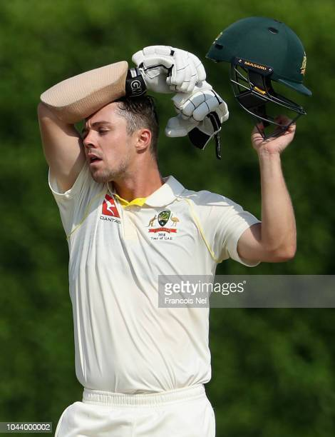 Travis Head of Australia wipes his face during day three of the tour match between Australia and Pakistan A at ICC Academy on October 1 2018 in Dubai...