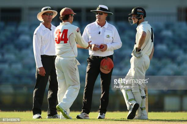 Travis Head of South Australia and Cameron Bancroft of Western Australia talk with umpires Tony Wilds and Mike GrahamSmith after the dismissal of...