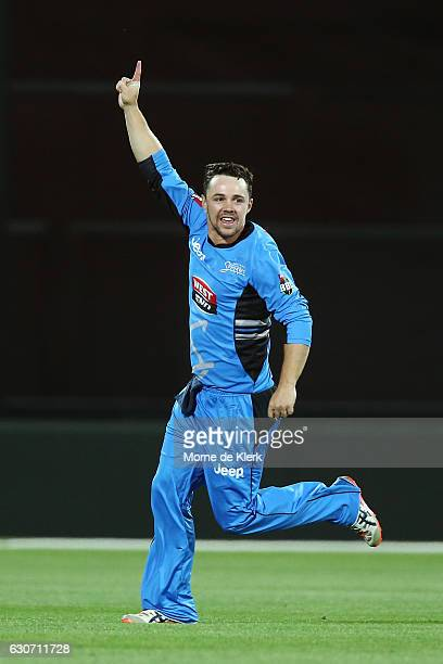 Travis Head of the Adelaide Strikers celebrates after getting the wicket of Nic Maddinson of the Sydney Sixers during the Big Bash League match...