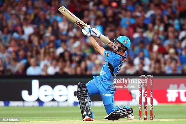 Travis Head of the Adelaide Strikers hits six during the Big Bash League match between the Adelaide Strikers and Perth Scorchers at Adelaide Oval on...