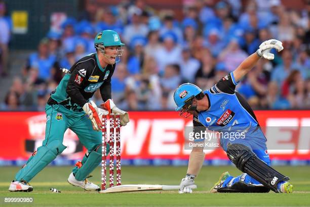 Travis Head of the Adelaide Strikers is bowled out by Yasir Shah of the Brisbane Heat during the Big Bash League match between the Adelaide Strikers...