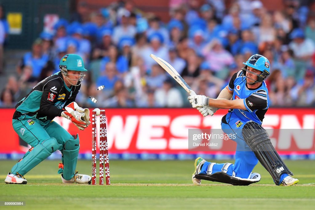 Travis Head of the Adelaide Strikers is bowled out by Yasir Shah of the Brisbane Heat during the Big Bash League match between the Adelaide Strikers and the Brisbane Heat at Adelaide Oval on December 31, 2017 in Adelaide, Australia.