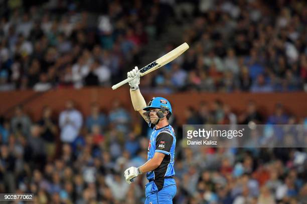 Travis Head of the Adelaide Strikers reacts after reaching his half century during the Big Bash League match between the Adelaide Strikers and the...