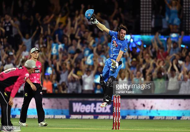 Travis Head of the Adelaide Strikers reacts after scoring his century and the winning runs during the Big Bash League match between the Adelaide...