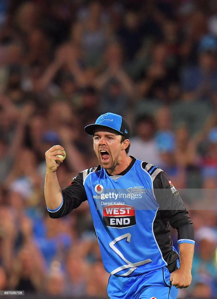 Travis Head of the Adelaide Strikers reacts after taking a catch to dismiss Aiden Blizzard of the Sydney Thunder during the Big Bash League match between the Adelaide Strikers and the Sydney Thunder at Adelaide Oval on December 22, 2017 in Adelaide, Australia.