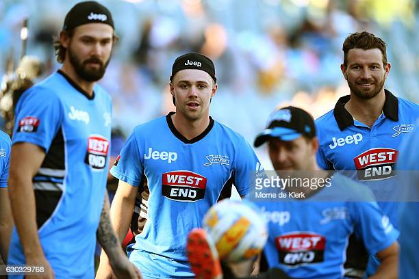 Travis Head of the Adelaide Strikers warms up with teammates before the Big Bash League match between the Adelaide Strikers and Brisbane Heat at...