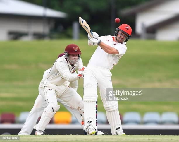 Travis Head of the Redbacks bats during day one of the Sheffield Shield match between Queensland and South Australia at Cazaly's Stadium on December...