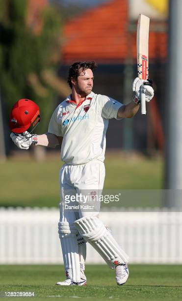Travis Head of the Redbacks celebrates after reaching his century during day three of the Sheffield Shield match between South Australia and Victoria...