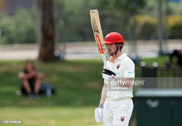 Travis Head of the Redbacks celebrates after reaching his half century at Karen Rolton Oval on October 22, 2020 in Adelaide, Australia.