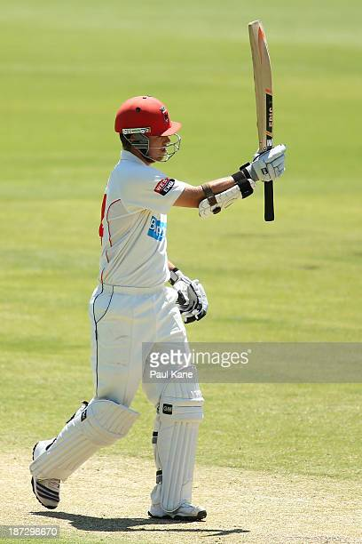 Travis Head of the Redbacks celebrates his half century during day three of the Sheffield Shield match between the Western Australia Warriors and the...