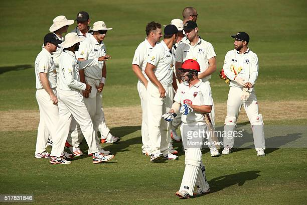 Travis Head of the Redbacks leaves the field after getting out to Jon Holland of the VIC Bushrangers during day 3 of the Sheffield Shield Final match...