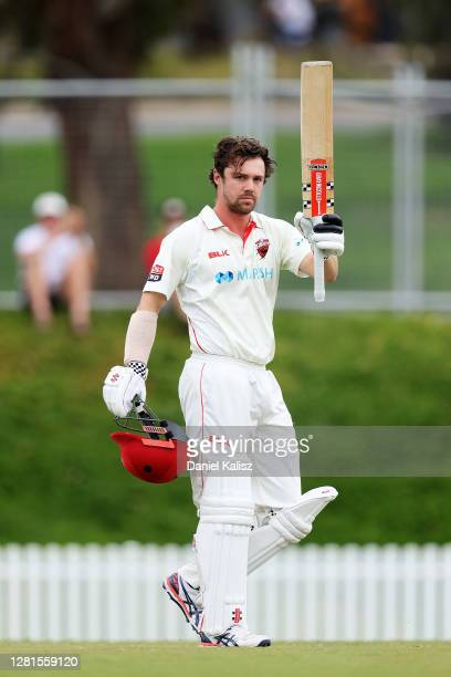 Travis Head of the Redbacks reacts after scoring a century at Karen Rolton Oval on October 22, 2020 in Adelaide, Australia.