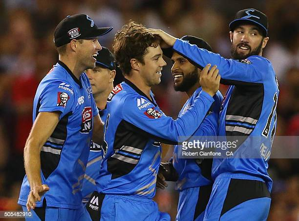 Travis Head of the Stikers celebrates after taking the wicket of Chris Gayle of the Renegades during the Big Bash League match between the Melbourne...
