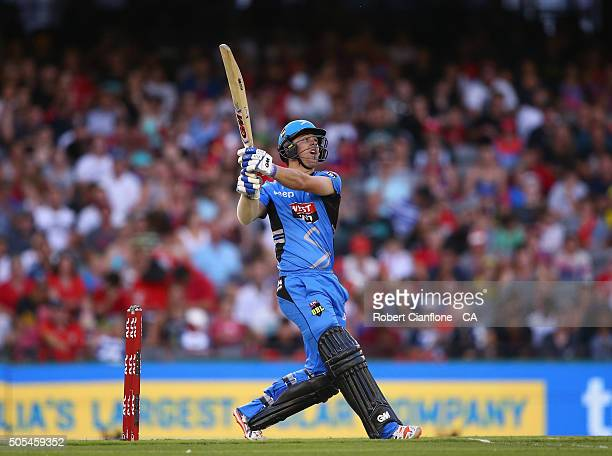 Travis Head of the Stikers hits out during the Big Bash League match between the Melbourne Renegades and the Adelaide Strikers at Etihad Stadium on...