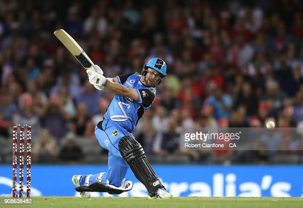 Travis Head of the Strikers bats during the Big Bash League match between the Melbourne Renegades and the Adelaide Strikers at Etihad Stadium on...