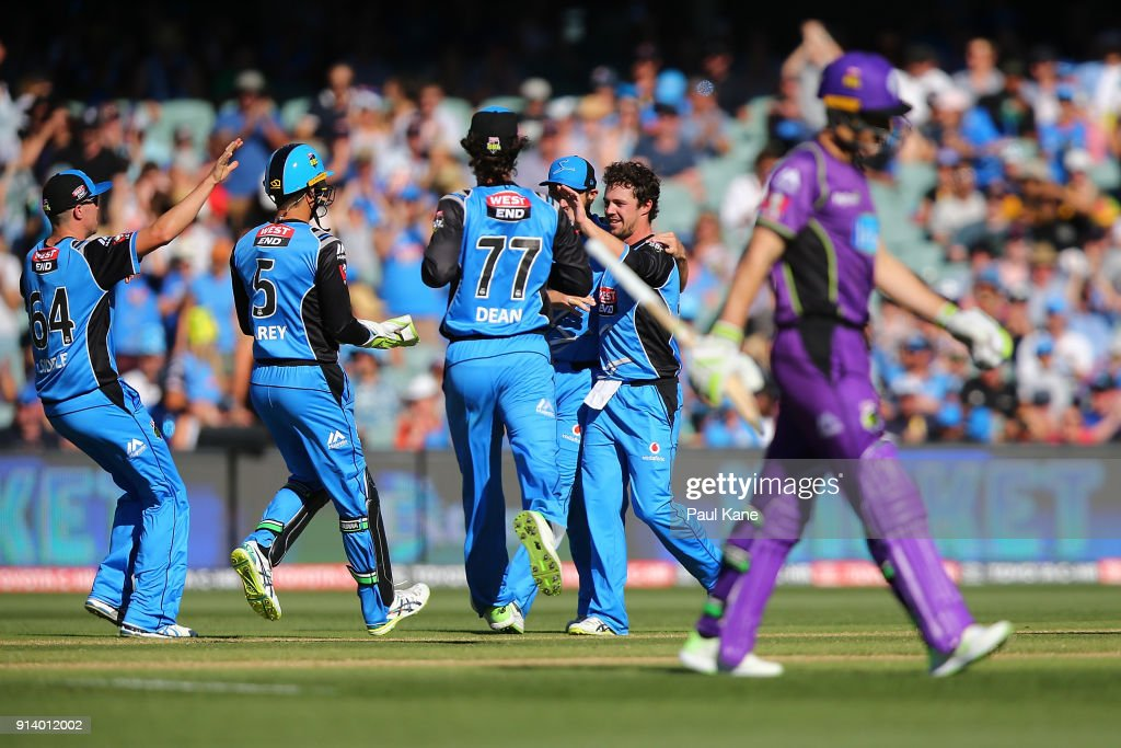 Travis Head of the Strikers celebrates the wicket of Tim Paine of the Hurricanes during the Big Bash League Final match between the Adelaide Strikers and the Hobart Hurricanes at Adelaide Oval on February 4, 2018 in Adelaide, Australia.